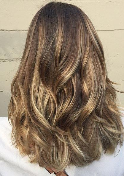 Layered blonde and brown hairstyle mix