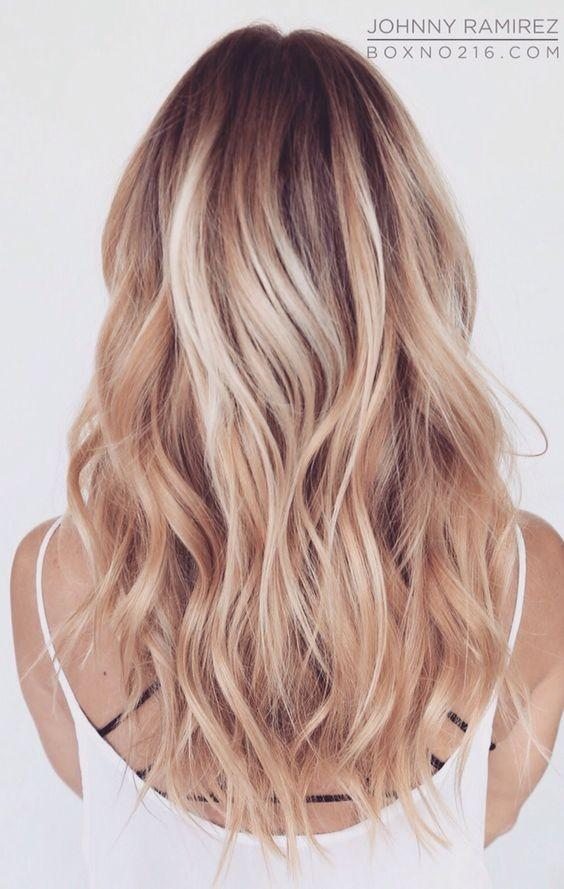 Layered blonde hairstyle for medium and long hair