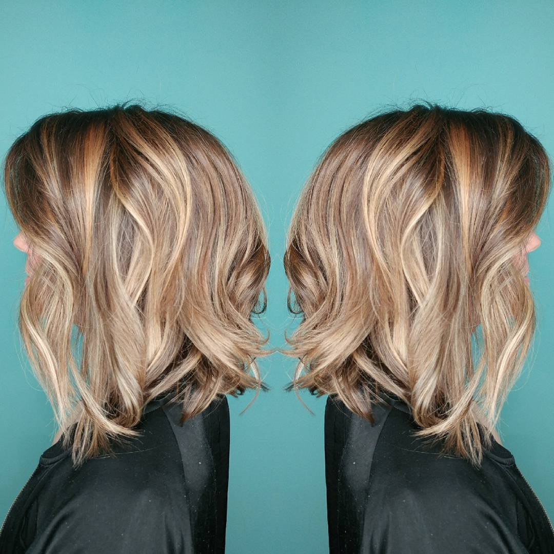 Lose curls with blonde graduated bob hairstyle