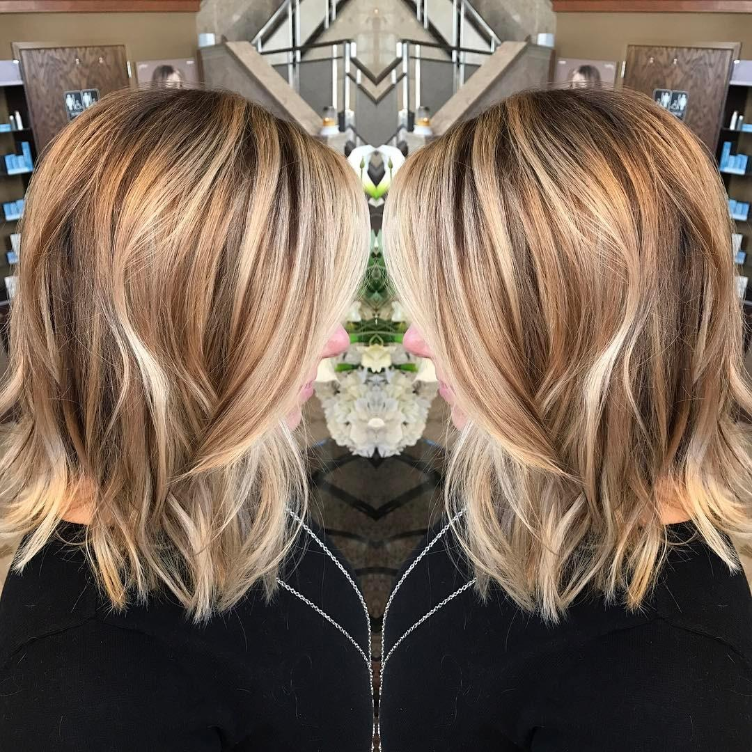 Women medium hairstyle with curly long blonde hair